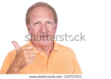 Handsome old man in orange polo-shirt shows thumb up