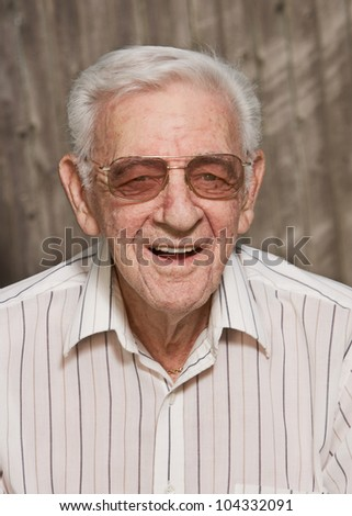 Handsome old man senior citizen with glasses - stock photo
