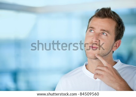 Handsome pensive man at the gym smiling - stock photo