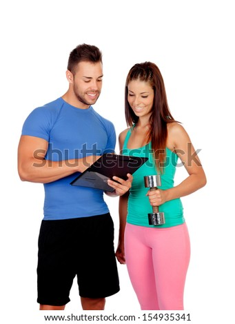 Handsome personal trainer with a attractive girl isolated on a white background - stock photo