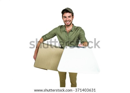 Handsome postman holding clipboard on white screen - stock photo