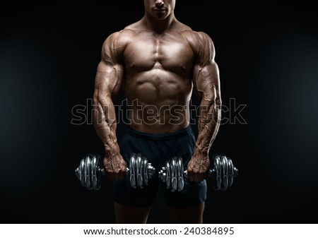 Handsome power athletic guy bodybuilder doing exercises with dumbbell. Fitness muscular body on dark background. - stock photo