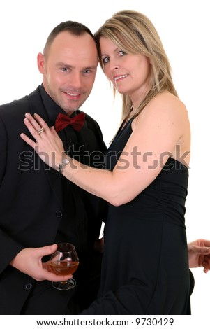Handsome pre middle aged male gigolo in formal suit with attractive female admirer, white background,  studio shot. - stock photo