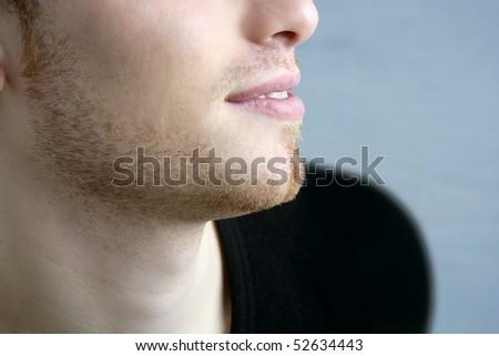 handsome profile smile portrait young man face detail closeup - stock photo
