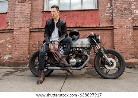 handsome rider biker man black leather stock photo 638897917
