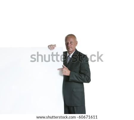 Handsome senior businessman with white billboard - stock photo