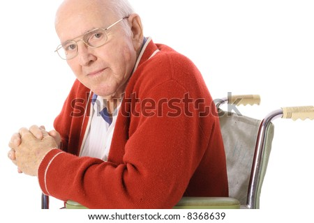 handsome senior citizen in wheelchair - stock photo