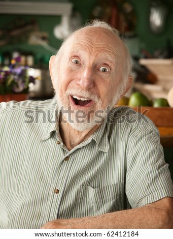 Handsome senior man at home in his house - stock photo