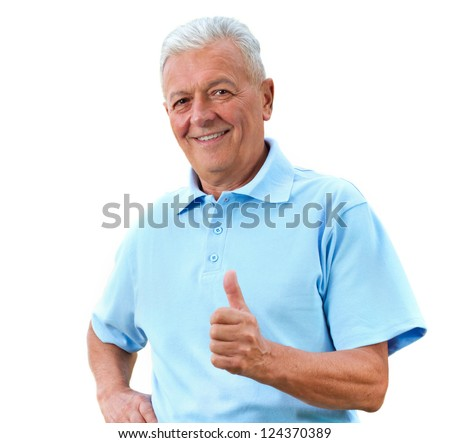 Handsome senior man in bright polo-shirt shows thumb up. - stock photo