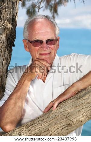 handsome senior man outdoors - stock photo