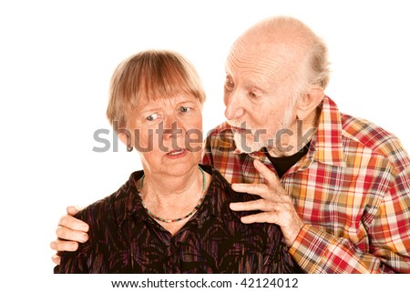 Handsome senior man sharing information with his concerned wife - stock photo