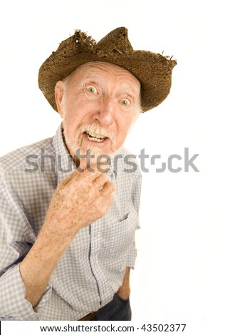 Handsome senior man wearing straw cowboy style hat - stock photo