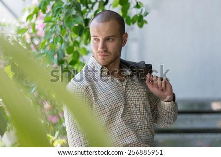 Handsome serious confident businessman portrait - stock photo