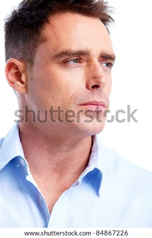 Handsome serious man. Isolated over white background