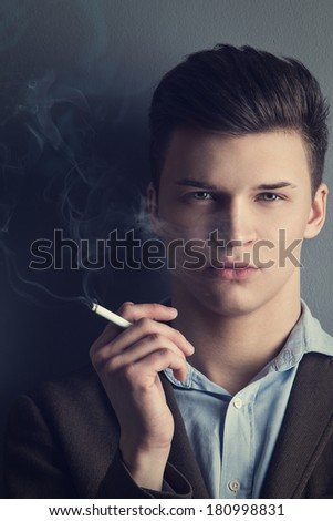 Handsome, serious man with cigarette