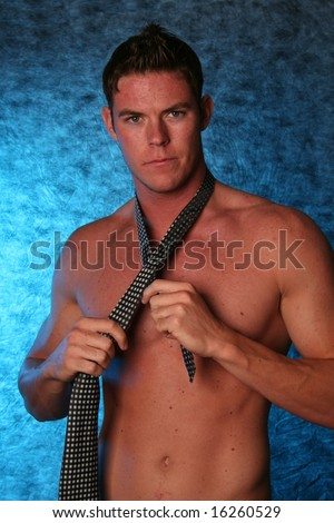 Handsome sexy male gigolo stripper Studio shot with black bow tie - stock photo