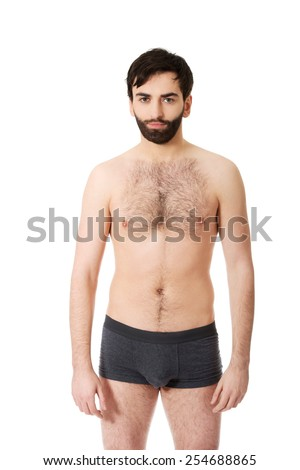 Handsome shirtless man smiling to camera.
