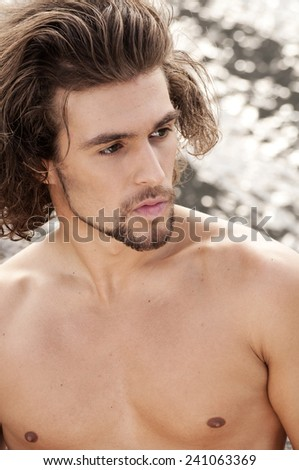 Handsome shitless young man - stock photo