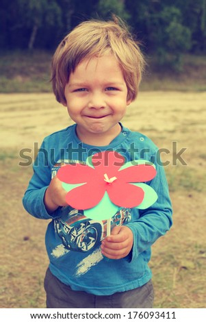 Handsome smiling boy on a background of nature on - stock photo