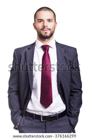 Handsome smiling business man isolated on a white background - stock photo