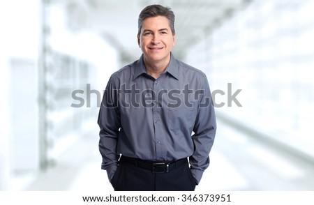 Handsome smiling businessman over blue background.  - stock photo