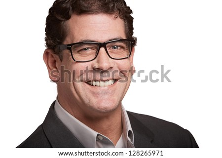 Handsome smiling businessman portrait isolated on white background - stock photo