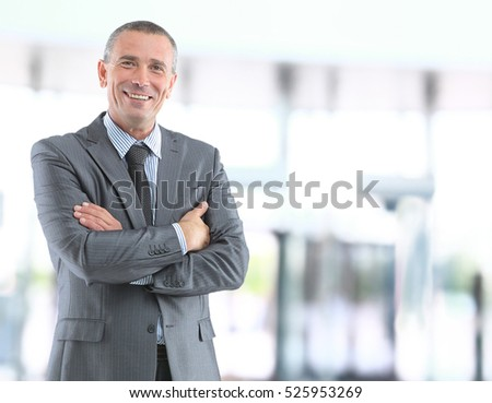 Handsome smiling confident businessman portrait