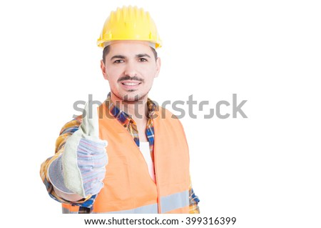 Handsome smiling engineer showing thumb up or like gesture as successful or approval sign concept with advertising area isolated on white - stock photo