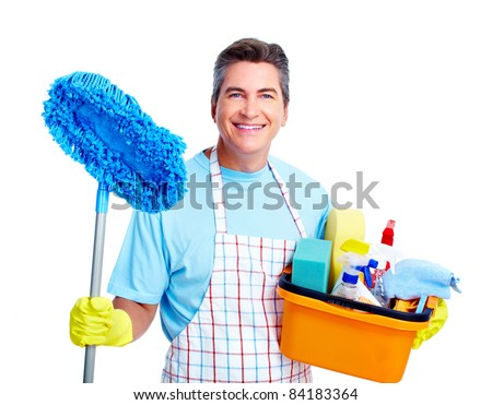 Handsome smiling man doing housework. Isolated over white. - stock photo
