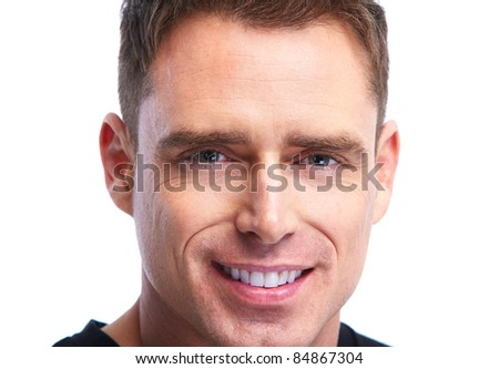 Handsome smiling man. Isolated over white background - stock photo