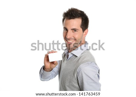 Handsome smiling man showing card - stock photo