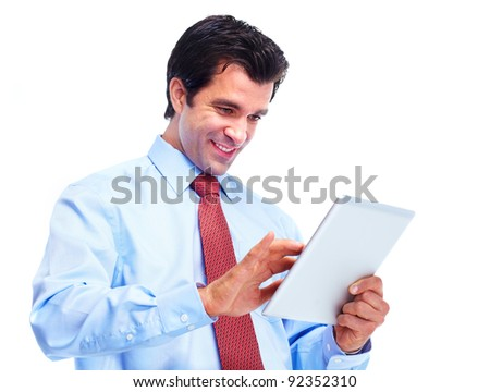 Handsome smiling man with tablet computer. Isolated over white background - stock photo