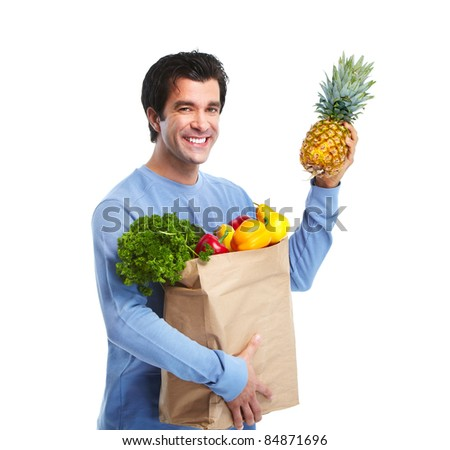 Handsome smiling man with vegetables. Isolated over white background.