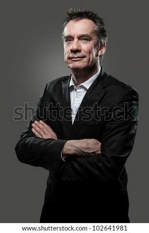 Handsome Smiling Middle Age Business Arms Folded Grey Background Grunge Look - stock photo
