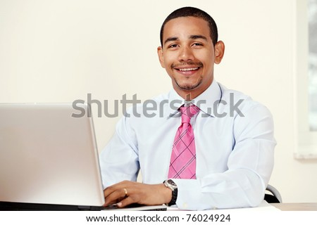Handsome smiling office or bank worker - stock photo