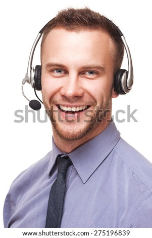 Handsome smiling young businessman using a headset isolated over white - stock photo