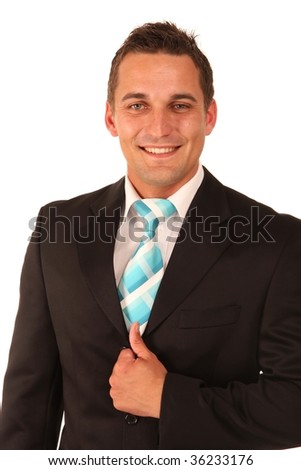 Handsome smiling young man dressed in jacket and tie