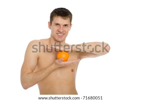 Handsome smiling young man with an orange. - stock photo