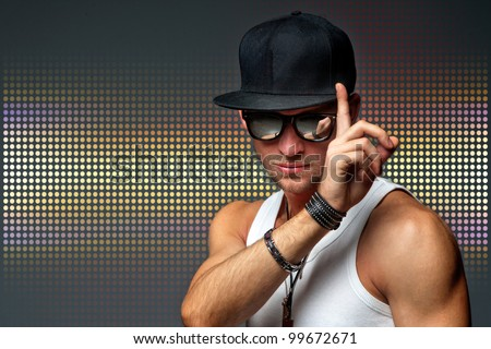 handsome sport man in a baseball cap - stock photo