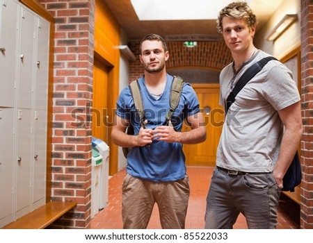 Handsome students posing in a corridor