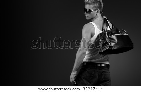 Handsome stylish man posing in sun glasses - stock photo