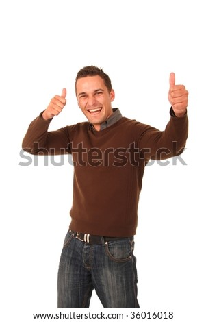 Handsome stylish young man with thumbs up and big grin - stock photo