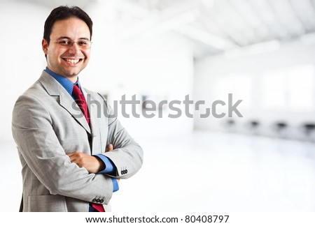 Handsome successful young businessman portrait - stock photo