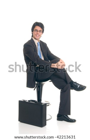 Handsome successful young businessman with briefcase, joyful expression, studio shot. - stock photo