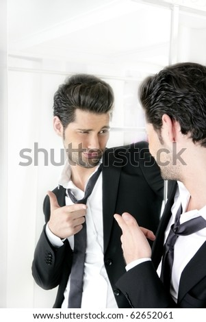 Handsome suit proud young man humor funny gesturing in a mirror - stock photo