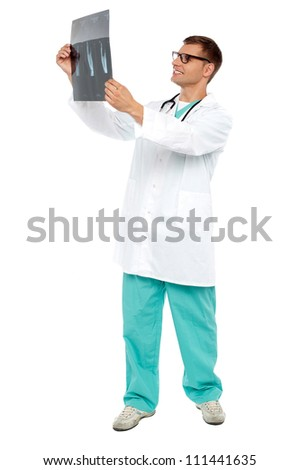 Handsome surgeon looking on patient,full length portrait