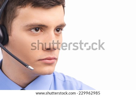 handsome technical support operator working on white. businessman with headset portrait at bright call center helpdesk support office  - stock photo