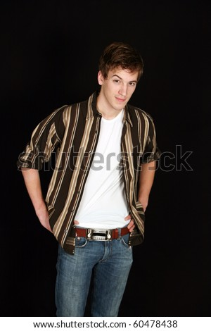 handsome teen boy in jeans and striped shirt