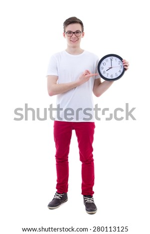 handsome teenage boy showing office clock isolated on white background