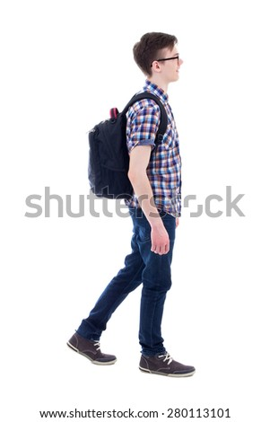 handsome teenage boy with backpack walking isolated on white background - stock photo